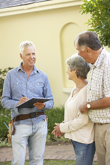 residential-restoration-Repairman-Giving-Senior-Couple